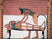 Anubis was the ancient Egyptian god associated with mummification and burial rituals; here, he attends to a mummy.