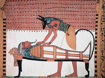 Anubis was the ancient Egyptian god associated with mummification and burial rituals; here, he attends to a mummy. - Ancient Egypt