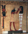 Anubis with a mummy.png