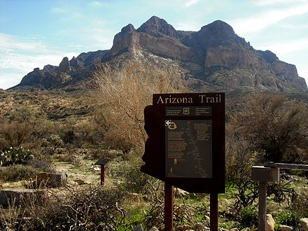 Sign for the Arizona Trail as it passes near Picketpost Mountain (background) in Superior, Arizona.