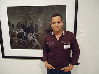 Phoenix Art Museum - Artist Werner Segarra in front of one of his photographic creations.