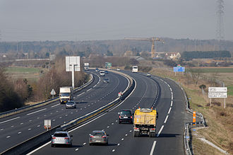 Controlled-access highway - The A10 near Orléans, France showing hard shoulder and emergency telephone. The broken demarcation line for the hard shoulder is specific to France, and serves as a safety reference mark for drivers: the advisory distance from the vehicle ahead is two dashes minimum.