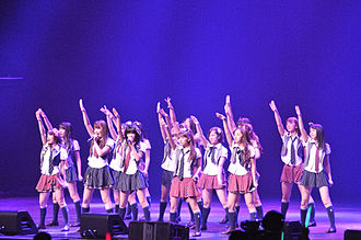 "Japanese idol - AKB48, a Guinness World Record holder for being the ""largest pop group"", with 2011 record sales of over $200 million in Japan alone"