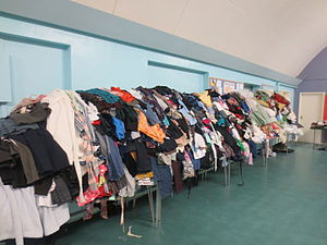 Jumble sale - Clothes piled high at the 5th Manchester Boys' Brigade Jumble Sale