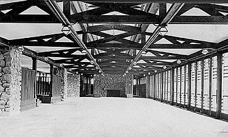Banff National Park Pavilion - Interior, circa 1913. Assembly lounge, art glass windows on the right, fireplace at the far end.