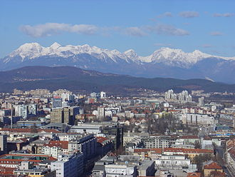 Bežigrad District - The northern edge of Ljubljana's center (foreground) and Bežigrad (middle), beneath the Kamnik Alps (in 2008)