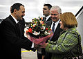 Becky Gates, right, wife of Secretary of Defense Robert M. Gates, receives flowers from the Deputy Minister of Defense of Ukraine Leonid Polyakov upon their arrival at the Boryspil International Airport in Kiev 071021-D-LB417-002.jpg