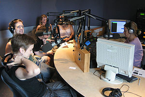 "KFAI - Belfast Poets Touring Group and Jill Anna Ponasik (foreground) on KFAI ""Art Matters"""
