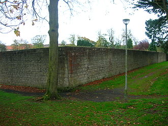 Walled garden - The exterior of a typical walled garden where the stone acts as a slow-release reradiator of solar energy.