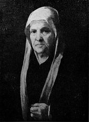 Portrait of an old woman with a rosary.
