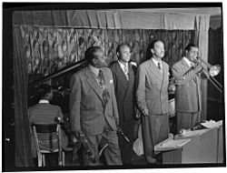 Ben Webster, Eddie Barefield, Buck Clayton, Benny Morton, Famous Door NYC, ca October 1947 (Gottlieb).jpg