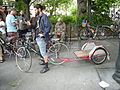 Bike with small flatbed trailer 01.jpg