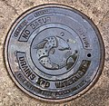 Bilingual manhole cover -English & Spanish.jpg