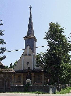 http://upload.wikimedia.org/wikipedia/commons/thumb/0/06/Biserica_de_lemn_din_Ulmeni.jpg/300px-Biserica_de_lemn_din_Ulmeni.jpg
