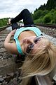 Blond woman on rail tracks 01.jpg