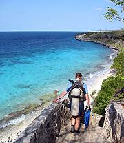 "A scuba diver approaching the ""1,000 Steps"" dive site in Bonaire."