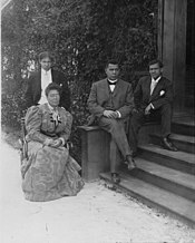 Booker T. Washington with third wife Margaret James Murray and his two sons.