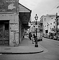 Bourbon Street at Bienville 1941- Sign on shop advertising costumes for Mardi Gras.jpg
