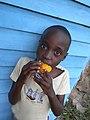 Boy eating a mango.jpg