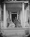 Brevet Brigadier General John E. Mulford, Colonel of 3rd New York Infantry, with His Wife and Mr. and Mrs. William Allen. This Picture was Taken on the Porch of Mr. Allen's House at Richmond, Virginia. (4190894338).jpg