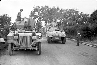 Breda Model 35 - A Breda 20/65 M35 mounted as the main armament on an Italian AB 41 armored car. The vehicle on the left is a German Sd.Kfz 10/5 mounting the 20 mm FlaK 38.