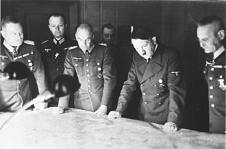 Wilhelm Keitel - Keitel (far left) and other members of the German high command with Adolf Hitler (second from right) at a military briefing, (c. 1940).