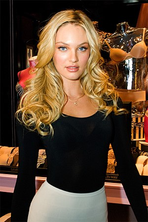 2010s in fashion -  South African model Candice Swanepoel wearing pantywaist top and bodycon skirt, 2010.