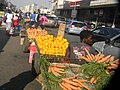 Carts loaded with fruits and vegetables for sale in Harare.jpg