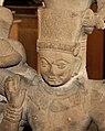 Caturvyuha, Vasudeva with ornate crown and flower necklace, making the Abhaya Mudra.jpg