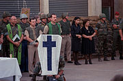 Chaplains, U.S. Marines and family members observe a moment of silence at memorial services for the 241 Marines killed during the terrorist bombing of the barracks at Beirut International Airport DM-SC-87-12363