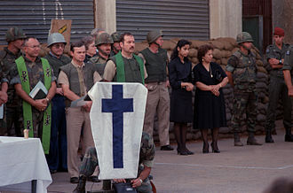 1983 Beirut barracks bombings - Chaplains, U.S. Marines, and family members observe a moment of silence during a memorial service