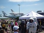 Child In Space Suit In Front Of Space Shuttle Endeavour.JPG