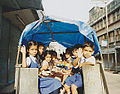 Children in Nepal who sit in a truck that rides.jpg