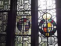 Coats of arms on stained glass window in the Parlour, Haddon Hall.jpg