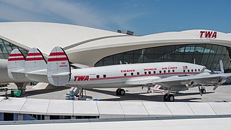 A Lockheed Constellation L-1649 Starliner in TWA livery, seen here parked at the TWA Hotel, which occupies the restored TWA Flight Center Constellation Starliner Airplane at TWA Hotel JFK Airport, New York City 20190521-jag9889.jpg