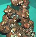 Copper crystals with cuprite coating (Mesoproterozoic, 1.05-1.06 Ga; Kearsarge Mine, Kearsarge, Michigan, USA) (17313358891).jpg
