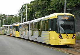 Coupled M5000 trams approaching Holt Town.jpg
