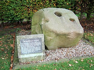 Siege of Lathom House - Cromwell's Stone. The hollows in the stone are said to have been used for casting shot by Cromwell's army in the siege of Lathom House.