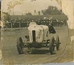 "Don Harkness at the wheel of his Overland Sports car ""Whitey"" at race meeting (4985418031).jpg"
