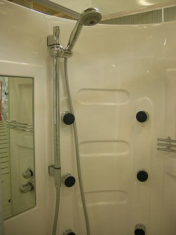 A shower cubicle with a showerhead.