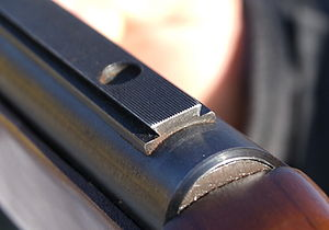 Dovetail rail - A dovetail rail on a rifle receiver for mounting a sight (i.e. a scope or iron sights).
