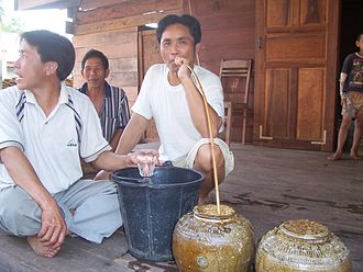Demographics of Laos - Lao men drinking lauhai (in Lao) or bujkdong (in Khmuic), a type of Lao rice whiskey which is ancient khmuic rice beer.