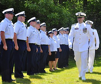 Warrant officer (United States) - CWO3 Pollock reviews his crewmates at Coast Guard Station Eatons Neck during his change-of-command ceremony
