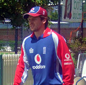 A man in an England long-sleeved cricket shirt and cap