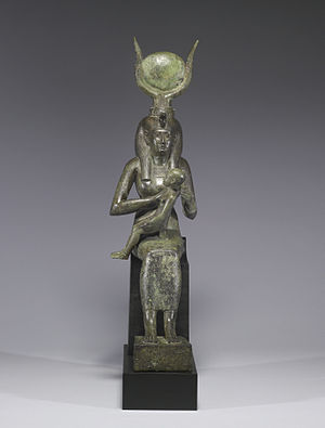 Radiant crown - Isis crowned by the sun-disk and cow horns and nursing Horus (680–640 BC)
