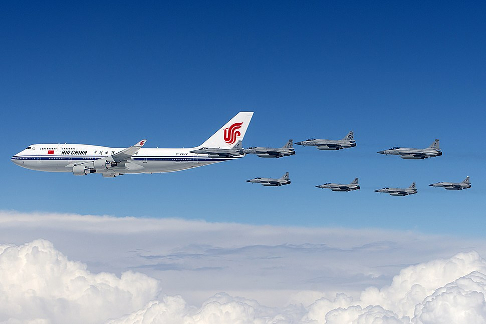 Eight Pakistan Air Force JF-17s escort Air China Boeing 747-400.jpg