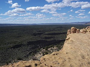 El Malpais National Monument - View of El Malpais Lava Fields and sandstone bluff