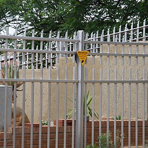 Electric fence - Residential Electric Palisade Fence in Johannesburg, South Africa. The top spikes are electrified while the bottom slats of the palisade are grounded.