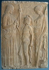 The Eleusinian trinity: Persephone, Triptolemos and Demeter, on a marble bas-relief from Eleusis, 440-30 BCE.