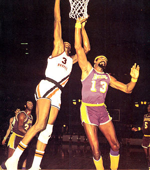 Elmore Smith - Smith (left) and Wilt Chamberlain battle for a rebound, circa 1971